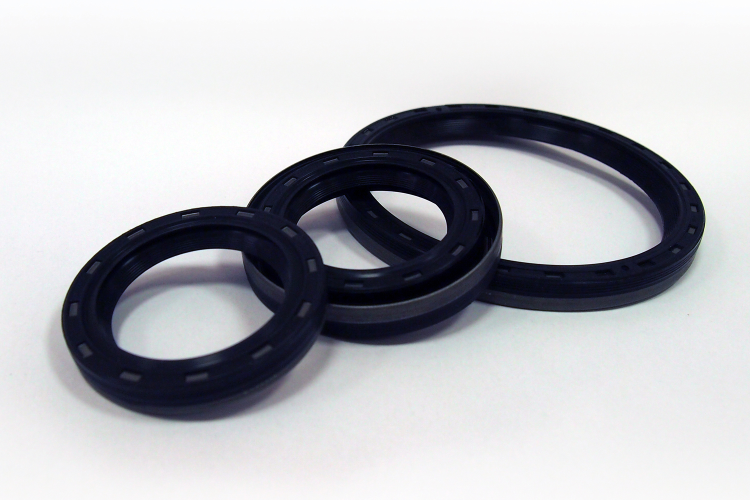 Three o-rings laying on a table for visual inspection purposes