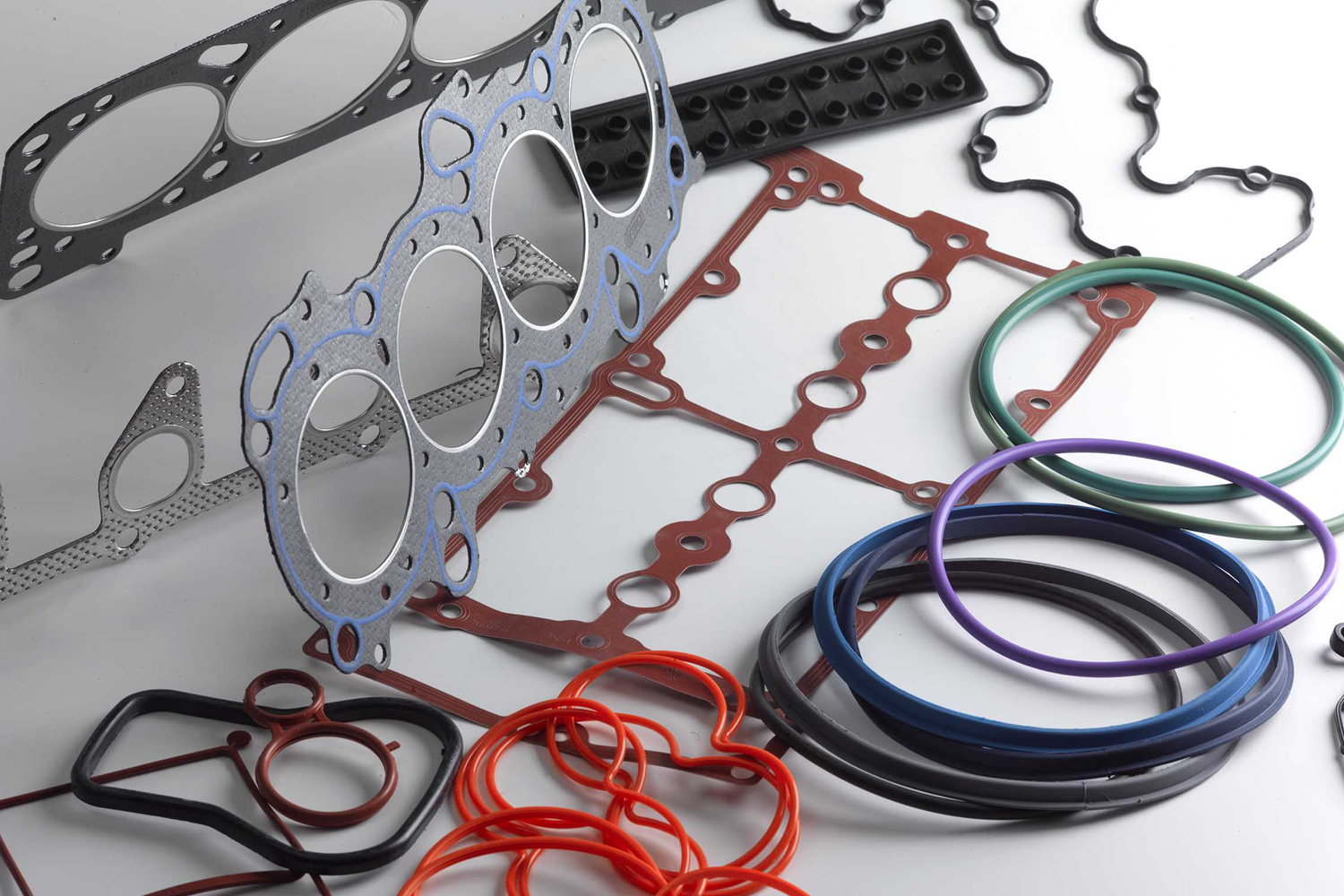 O-rings and cutouts on a flat surface for visual inspection purposes