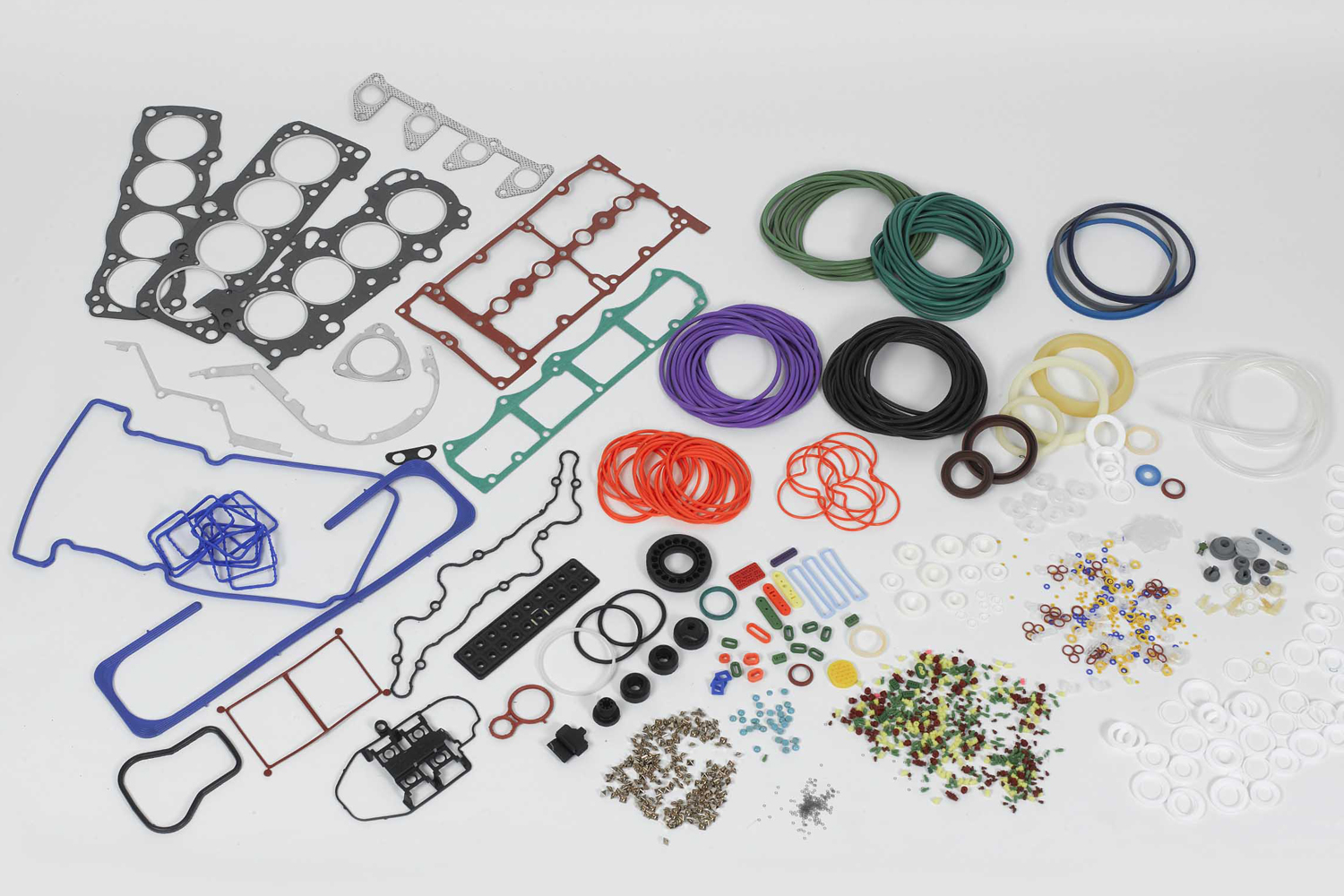 A bunch of o-rings and rubber parts laid out on a table for visual inspection